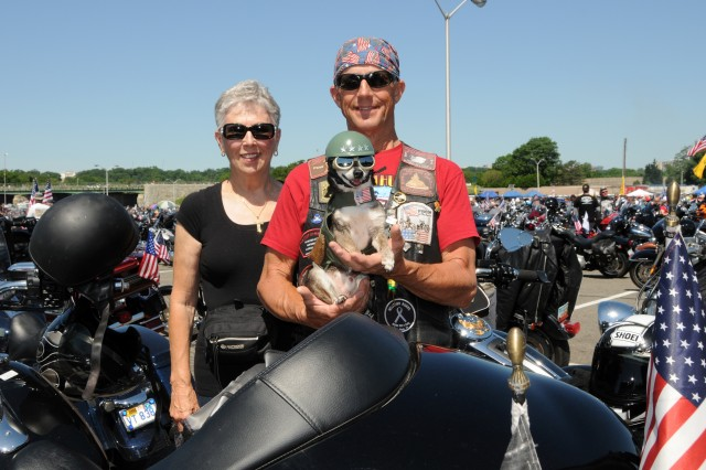 "Carol Sours, husband Buddy Sours, a U.S. Army veteran of the Vietnam War, and dog Isaiah, participated in the 27th annual Rolling Thunder Motorcycle rally in support of POWs and MIAs. At the Pentagon in Arlington, Va., tens of thousands of motorcyclists gathered to participate in the 27th ""Rolling Thunder"" motorcycle rally, May 25, 2014. The event is in its 27th year now. Participants from around the United States gathered at the Pentagon before embarking on a ride around the National Mall in Washington, D.C. The rally brings attention to prisoners of war and those missing in action."