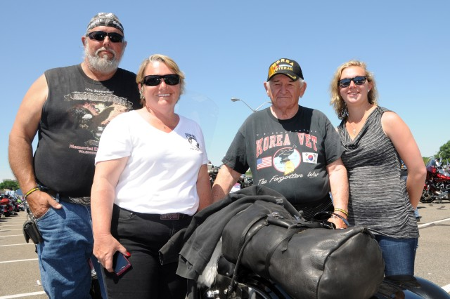 "Jim Lawrence, a U.S. Army veteran of the Vietnam War; wife Paula Harper; her father, Frank Harper, who is an Air Force veteran of the Korean war; and Jim and Paula's daughter, Haylee Harper, participated in the 27th annual Rolling Thunder Motorcycle rally in support of POWs and MIAs.  At the Pentagon in Arlington, Va., tens of thousands of motorcyclists gathered to participate in the 27th ""Rolling Thunder"" motorcycle rally, May 25, 2014. The event is in its 27th year now. Participants from around the United States gathered at the Pentagon before embarking on a ride around the National Mall in Washington, D.C. The rally brings attention to prisoners of war and those missing in action."
