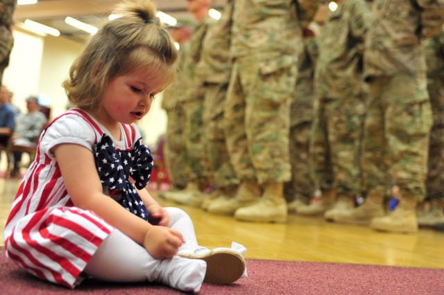 Briana Leigh Garland, the daughter of Sgt. Michael Garland, a Soldier assigned to the 21st Theater Sustainment Command's 1177th Movement Control Team, 7th Civil Support Command, waits for her father to be released from formation during a redeployment ceremony at the Kaiserslautern Community Activity Center on Daenner Kaserne May 26. The 1177th MCT returned after a nine-month deployment to Afghanistan.