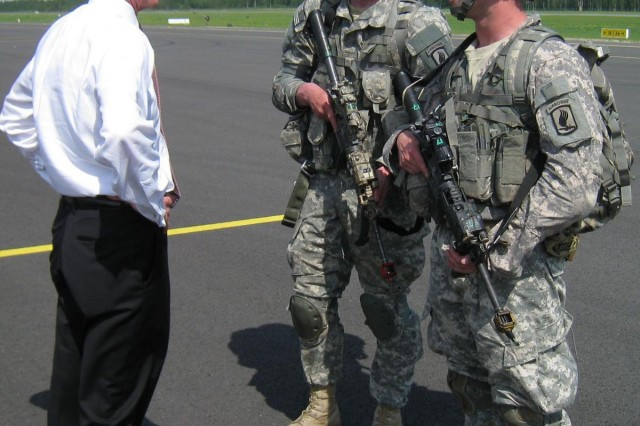 "Secretary of the Army John M. McHugh greets paratroopers assigned to 1st Battalion, 503rd Infantry Regiment, 173rd Airborne Brigade, May 20, 2014. The ""Sky Soldiers"" from the 173rd Airborne had just parachuted from a C-130 aircraft at Lielvarde Air Base, Latvia, as part of a training exercise."