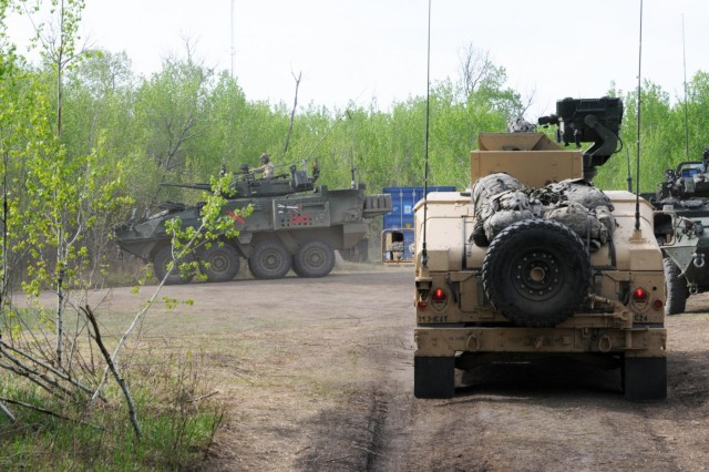 Soldiers of the 3rd Squadron, 1st Cavalry Regiment, 3rd Infantry Division out of Fort Benning, Ga., depart base camp during operations as the opposition force during Exercise Maple Resolve 2014 (EX MR14). Approximately 5,000 Canadian, British and U.S. troops participated in EX MR14, conducted here May 5-June 1. It is the culminating collective training event that validates the Canadian Army's High Readiness force for operations assigned to it by the Canadian government through the Chief of Defense Staff.
