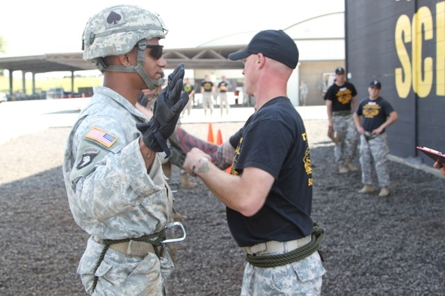 Spc. Anthony Hendrix, a rifleman from B Company, 2nd Battalion, 506 Infantry Regiment, 3rd Brigade Combat Team, gets checked by an instructor at The Sabalauski Air Assault School prior to rappelling at the 2014 Week of the Eagles Best Air Assault Soldier Competition, May 20.