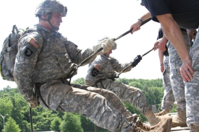 First Lt. Scott Oplinger, C Company, 3rd Battalion, 187th Infantry Regiment, 3rd Brigade Combat Team executive officer, listens to instructions from an instructor at The Sabalauski Air Assault School prior to rappelling at the 2014 Week of the Eagles Best Air Assault Soldier Competition.