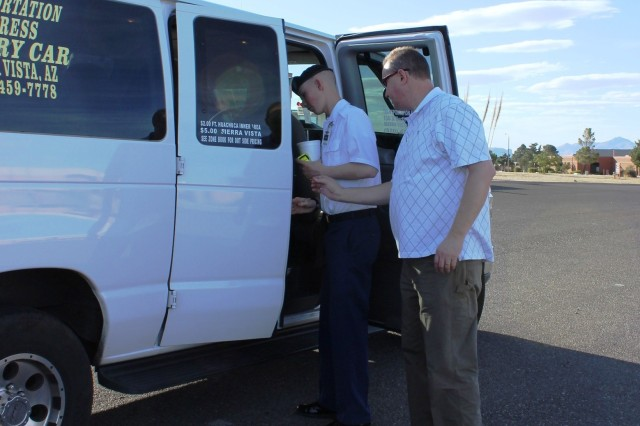 From left, Pvt. Colin Hare, Company A, 305th Military Intelligence Battalion, and father Brian Hare enter a Transportation Express van to shuttle them back to the Soldier's barracks. Not only does Transportation Express provide services for the Safe Ride Program, it also assists Soldiers without transportation on post.
