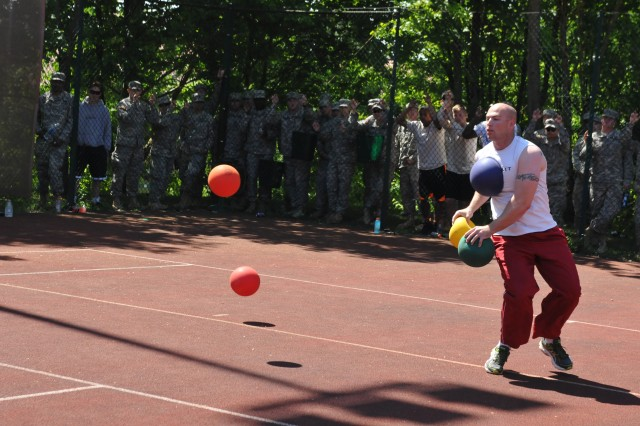 ROSE BARRACKS, Germany -- A Trooper assigned to the 2d Cavalry Regiment is hit with a ball during a dodge ball tournament May 21, 2014, at Rose Barracks, Germany. The Troopers competed in a number of sporting tournaments designed to promote camaraderie and teamwork.