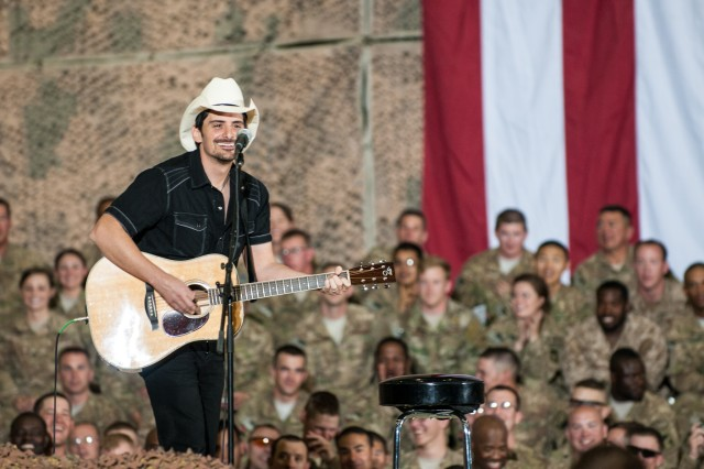 Country music artist Brad Paisley performs for deployed troops at Bagram Airfield during a surprise visit to Afghanistan. Paisley, along with President Barack Obama visited with thousands of service members and civilians on the eve of Memorial Day.