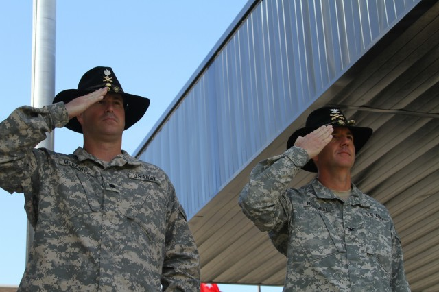 Lt. Col. Kenneth McDaniel, commander of 1st Battalion, 21st Field Artillery Regiment, Task Force Pegasus Fires, left, and Col. Cory Mendenhall, commander of 1st Air Cavalry Brigade, 1st Cavalry Division, right, salute the American colors during a relinquishment of command ceremony at Fort Hood, Texas, April 10. Lt. Col. Kenneth McDaniel relinquished command of 1st Battalion, 21st Field Artillery Regiment, Task Force Pegasus Fires, as the battalion prepares for inactivation (U.S. Army photo by Sgt. Garett Hernandez, Task Force Pegasus Fires Public Affairs).