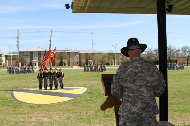 Lt. Col. Kenneth McDaniel, commander of 1st Battalion, 21st Field Artillery Regiment, Task Force Pegasus Fires, speaks to the Soldiers of the battalion for the last time during a relinquishment of command ceremony at Fort Hood, Texas, April 10. Lt. Col. Kenneth McDaniel relinquished command of 1-21st FAR as the battalion prepares for inactivation (U.S. Army photo by Sgt. Garett Hernandez, Task Force Pegasus Fires Public Affairs).