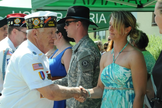 Veterans of Foreign Wars members thank the Gold Star Families in attendance at the Memorial Day ceremony on Tower Barracks, May 22.
