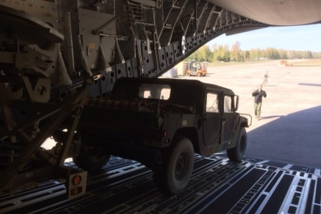 A Humvee is unloaded from a C-17 in Lithuania, shortly after the arrival of more than 130 paratroopers from the 173rd Airborne Brigade, April 24, 2014. The U.S. paratroopers are scheduled to conduct multinational training activities with their counterparts from the Lithuanian Army over the next few months. Making sure all 173rd paratroopers and equipment items were accounted for, loaded up and headed to training areas were Soldiers from U.S. Army Europe, G-4 Section (Logistics), and the 21st Theater Sustainment Command, Special Operations, Transportation Integration Branch.