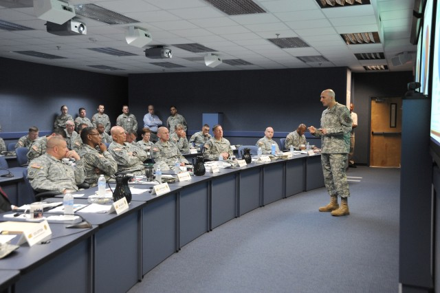 FORT GORDON, Ga. (May 24, 2014) - Garrison Commander Col. Samuel G. Anderson briefs Army Chief of Staff Gen. Raymond Odierno during his visit Wednesday to Fort Gordon and the Cyber Center of Excellence.