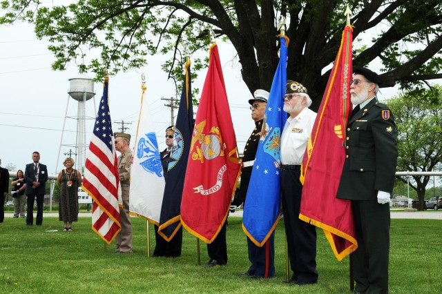 Members of the Burlington, Iowa, area Veterans Honor Guard post the colors during the Memorial Day Ceremony held May 22 at the Iowa Army Ammunition Plant.