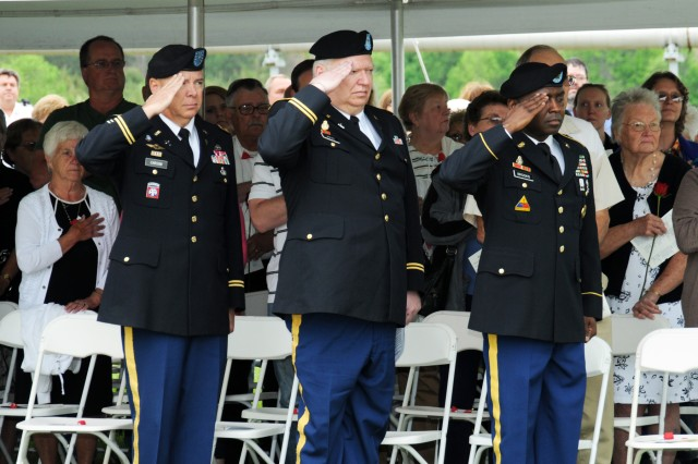 Left to right; Chaplain (Col.) Scott Carson, Army Materiel Command; Chaplain (Maj.) Terry Jarvis, Joint Munitions Command; and Sgt. Maj. Ron Brooks, Army Materiel Command, salute during the Memorial Day Ceremony held May 22 at the Iowa Army Ammunition Plant.