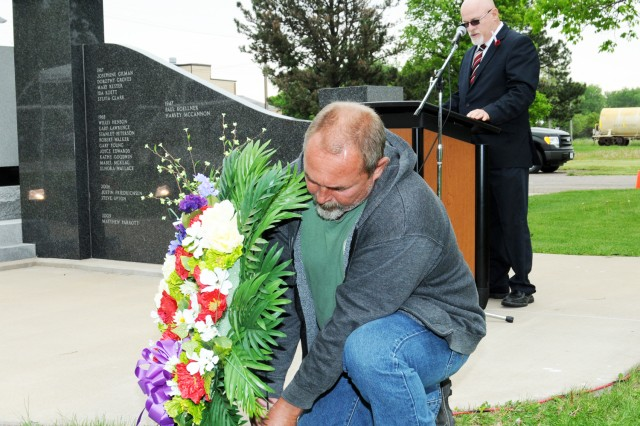 Clayton Huss, American Ordnance employee, places a wreath to recognize the fallen during the Memorial Day Ceremony held May 22 at the Iowa Army Ammunition Plant.