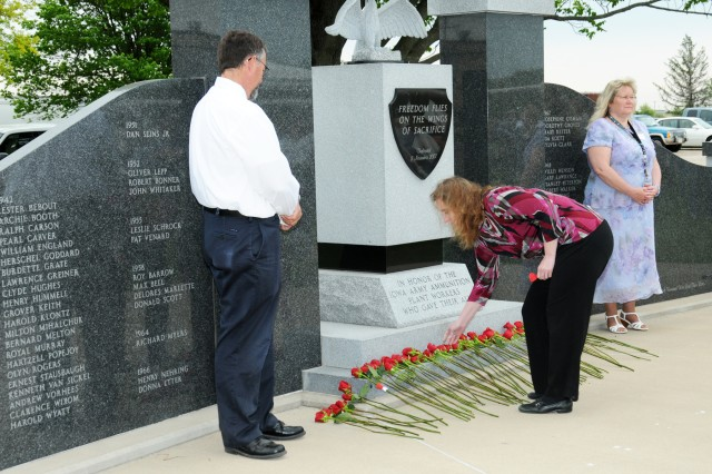 Family members and American Ordnance employees placed a rose for each of the 69 fallen employees recognized during the Memorial Day Ceremony held May 22 at the Iowa Army Ammunition Plant.