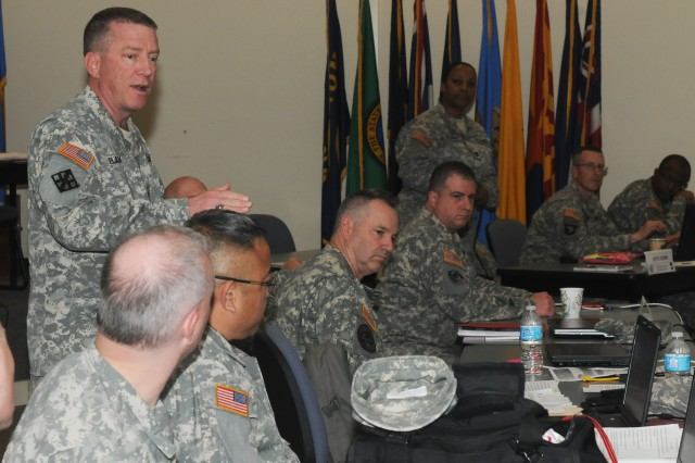 Brig. Gen. John J. Elam, commander 102d Training Division, participates in class discussion while attending The Army School System Leader course at Fort Knox, Ky., April 28, 2014. The course familiarizes leaders who transfer from the operational and functional environment with TASS policies and procedures in accordance with U.S. Army Training and Doctrine Command Regulation 350-18