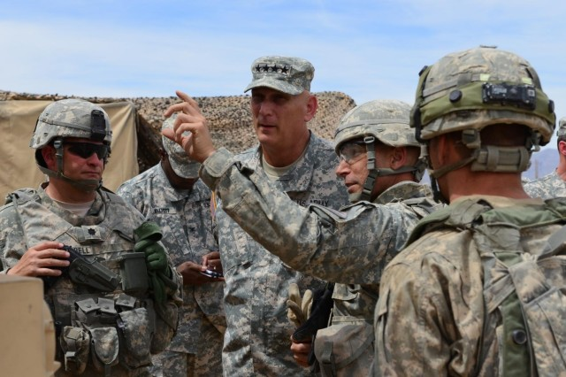 Col. Thomas Dorame, the brigade commander for 2nd Brigade Combat Team, 1st Armored Division, briefs Chief of staff of the Army Gen. Ray Odierno during his visit to the Network Integration Evaluation 14.2, at Fort Bliss, Texas, and White Sands Missile Range, N.M.