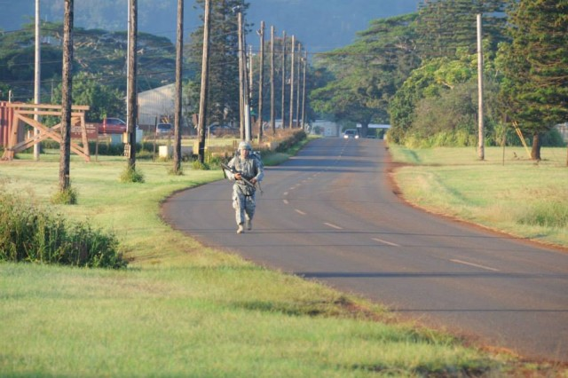 Pfc. Andrew Lee, 501st Signal Company, 36th Signal Battalion, Korea conducts a tactical foot march during the 311th Signal Command (Theater) Best Warrior Competition, May 9-13, 2014 on Schofield Barracks, Hawaii. Lee went on to win the Signal Command's Soldier of the Year award.