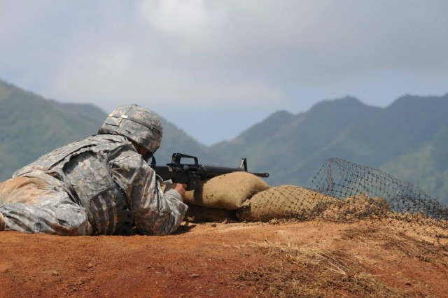 A Soldiers attempts to qualify with his weapon during the 311th Signal Command (Theater)  Best Warrior Competition, May 9-13, 2014 on Schofield Barracks, Hawaii.