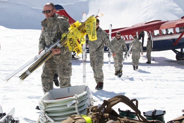 Members of the 1st Stryker Brigade Combat Team, 25th Infantry Division, climbing team unload supplies at Kahiltna Glacier Base Camp, Alaska, May 21, 2014. The Fort Wainwright-based team began their ascent to the summit of Mount McKinley, which at 20,320 feet, is the tallest mountain in North America. The team is prepared to spend 14-21 days ascending more than 13,000 feet in some of the most severe conditions in Alaska. The expedition validates training procedures used to maintain readiness for operating in austere, high-altitude, extreme cold-weather environments.