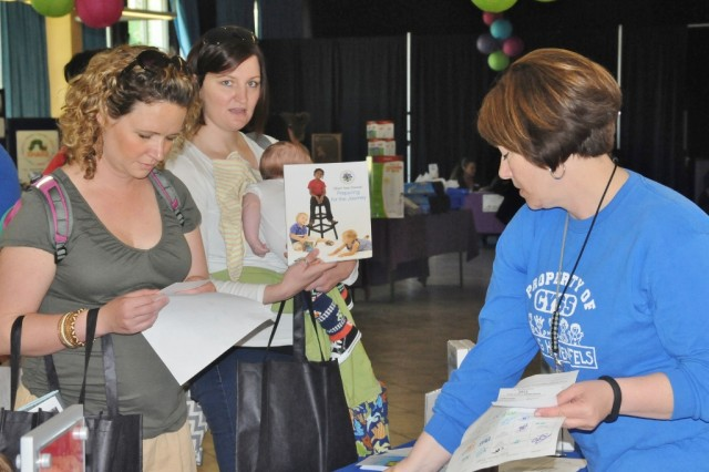 A Child, Youth and School Services volunteer hands out information on CYSS programs during the Hohenfels Baby Bazaar, recently.