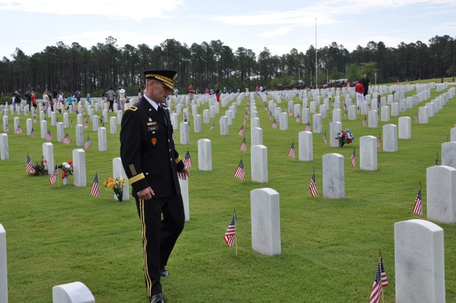 Brig. Gen. Bradley Becker, Fort Jackson's commanding general, pays his respects to the fallen at Fort Jackson National Cemetery during a Memorial Day observance at the Fort Jackson National Cemetery May 26, 2014.