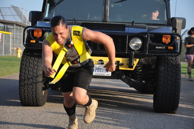 Maria Dievers, of the17th MP Detachment/Physical Security, pulls a Humvee 100 feet during the Fort Jackson Strongman Competition at Hilton Field, May 17, 2014. Dievers took first place in the Female Lightweight Division.