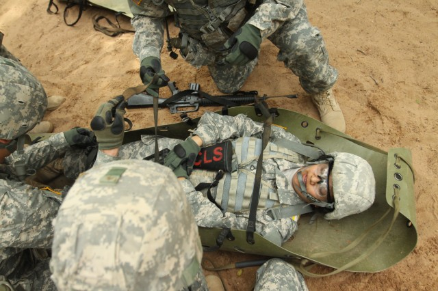 "Soldiers in B Battery, 1st Battalion, 19th Field Artillery tackle the Combat Life Saver course May 23, 2014, at Fort Sill, Okla., by strapping in a ""casualty"" to pull that person to safety."