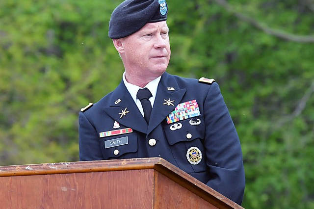 Col. Scott Smith, U.S. Army Sustainment Command, Rock Island Arsenal, Ill., addresses about 75 people attending the Memorial Day ceremony at Donahue, Iowa, May 26, in Allen's Grove Cemetery.