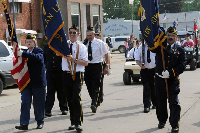 Members of American Legion Post 602 march up Main Street in Preston, Iowa, during a Memorial Day ceremony, May 26.
