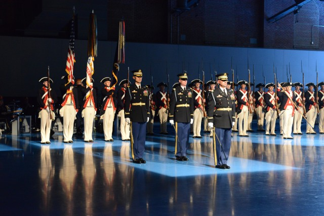 """Soldiers from the 3rd U.S. Infantry Regiment (The Old Guard) and the U.S. Army Band """"Pershing's Own"""" perform during the performance of Twilight Tattoo, at Joint Base Myer - Henderson Hall, May 28, 2014."""