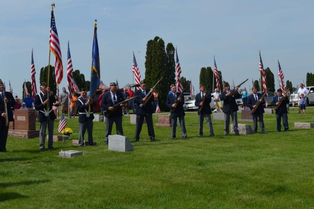 The Honor Guard from American Legion Post 45 conduct a rifle salute in Galva, Ill.