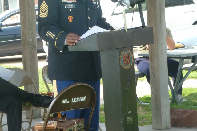 1st Sgt. Previn Parker, Headquarters and Headquarters Company, U.S. Army Sustainment Command, addresses a group of residents at the Riverfront Park in Sabula, Iowa, during the Memorial Day service May 26. Sabula's American Legion Post 74 hosted the event.