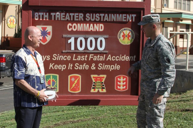 The 8th Theater Sustainment Command's Safety Officer, Tim Ah Young-Shelton, and 8th TSC Commander Maj. Gen. Steve Lyons change their safety record to 1,000 accidental death-free days, a safety milestone. The record includes no accidental deaths, either on or off duty, in over three years.