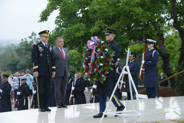 Maj. Gen. Jeffrey S. Buchanan, Joint Force Headquarters-National Capital Region/U.S. Army Military District of Washington commanding general, prepares to lay a wreath, on behalf of the President, at the grave of former President John F. Kennedy, in recognition of JFK's birthday in Arlington National Cemetery, May 29, 2014.