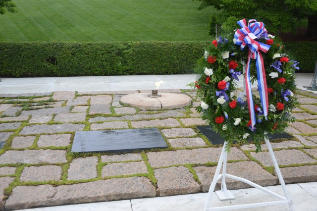 A wreath laid by Maj. Gen. Jeffrey S. Buchanan, Joint Force Headquarters-National Capital Region/U.S. Army Military District of Washington commanding general, on behalf of the President, sits in front of the grave of former President John F. Kennedy in Arlington National Cemetery, May 29, 2014.