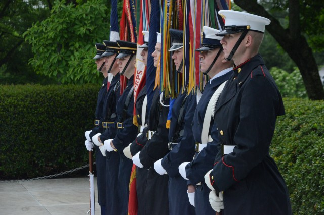 A Joint Armed Services Color Guard stands at ease prior to a Presidential Armed Forces Full Honors Wreath Laying Ceremony at the gravesite of former President John F. Kennedy, May 29, 2014.