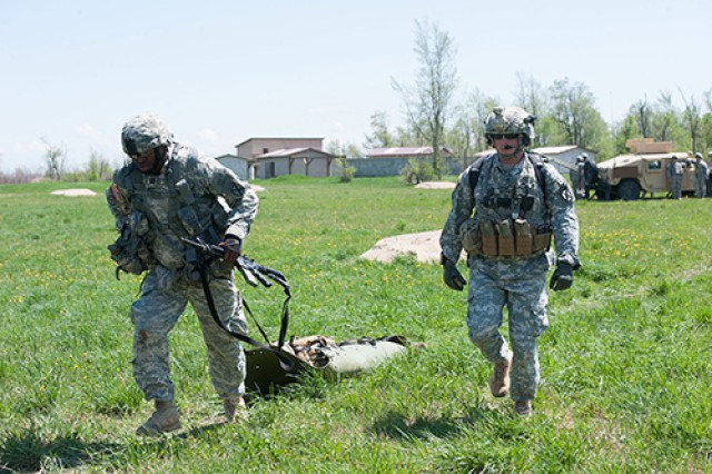 Capt. Alhaji A. Fonah, S1 officer in charge, 1st Brigade Special Troops Battalion, 1st Brigade Combat Team, pulls a 200-pound training aid during a stress shoot event as part of a field training exercise in which Soldiers were pushed to their limits to improve their mental resiliency and combat preparedness. The purpose of the exercise was to challenge and improve the Soldiers' mental toughness and prepare them for unconventional missions in austere and unimproved locations.