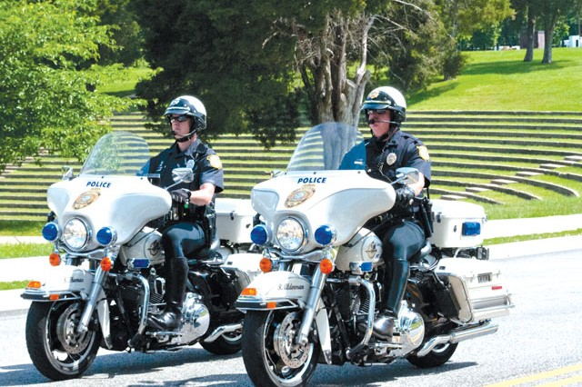 Officer Stephen Thomas, left, and Lt. Robert Alderman, both of the Fort Belvoir Police Department Motorcycle Unit, ride through Fort Belvoir, May 20. The maneuverability of the motorcycle on crowded streets offer advantages not provided by larger, more traditional police vehicles.