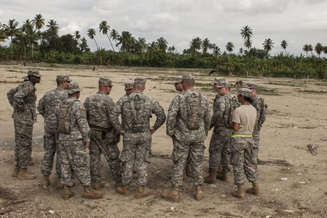 Army Staff Sgt. Cody L. Schmidt, project manager for clinic construction site in Vincente Noble, Dominican Republic, briefs soldiers of the 358th Engineer Company out of New Cumberland, Pa., about their role as security for the medical evacuation site on May 19. The 358th is here as part of the Beyond the Horizon 2014 mission to build schools and medical clinics for the local residents of Barahona. (U.S. Army photo by Sgt. Lindsey Schulte, 364th Press Camp Headquarters, Task Force Larimar)