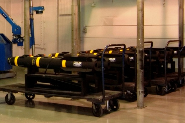 Four Hellfire missiles await final inspection before being loaded and shipped to Iraq. The missiles are part of an urgent Foreign Military Sales case implemented earlier this year.