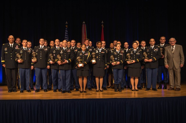 Recipients of the Gen. Douglas MacArthur Leadership Award pose for a group photo after the ceremony at the Pentagon, May 30, 2014. Twenty-eight  company-grade officers were honored at the Pentagon ceremony. The Douglas MacArthur Leadership award is presented annually to company-grade officers who epitomize the values championed by MacArthur: duty honor and country.