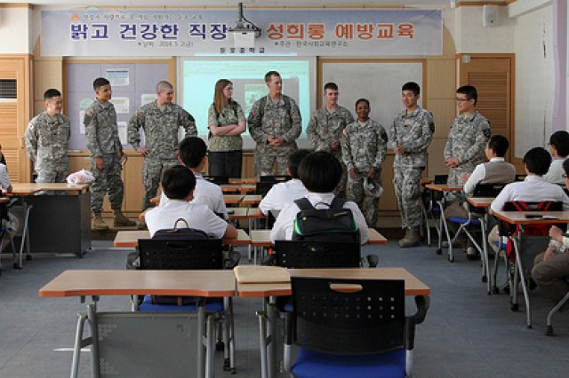 Soldiers from 602nd Aviation Support Battalion, 2nd Combat Aviation Brigade, 2nd Infantry Division, introduce themselves to the class during a visit to Dunpo Middle School, May 20, in Asan, South Korea. The Soldiers helped 7th and 8th graders learn English, as a part of the battalion's Good Neighbor Program.  (U.S. Army photo by Sgt. Nicole Hall/ 2nd CAB Public Affairs/Released)