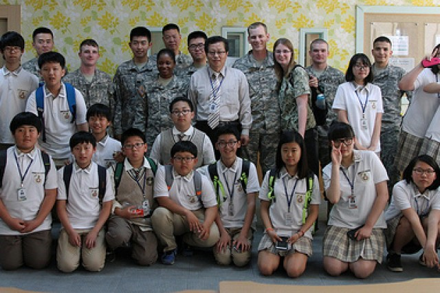 Dunpo Middle School students, their English language teacher, principle and 602nd Aviation Support Battalion, , 2nd Combat Aviation Brigade, 2nd Infantry Division, Soldiers pose for a picture at the end of class, May 20, in Asan, South Korea. The Soldiers helped 7th and 8th graders learn English, as a part of the battalion's Good Neighbor Program.  (U.S. Army photo by Sgt. Nicole Hall/ 2nd CAB Public Affairs/Released)