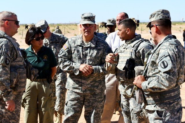 From left Lt. Col Ernest Tornabell, deputy commander of 2nd Brigade Combat Team, 1st Armored Division, Ms. Heidi Shyu, Assistant Secretary of the Army for Acquisition, Logistics and Technology, Gen. John F. Campbell, vice chief of staff of the Army, Col. Thomas Dorame, commander of 2nd Brigade Combat Team, 1st Armored Division, and Brig. Gen. John Charlton, commanding general of the Brigade Modernization Command, touring tactical operation sites, during the Network Integration Evaluation 14.2.