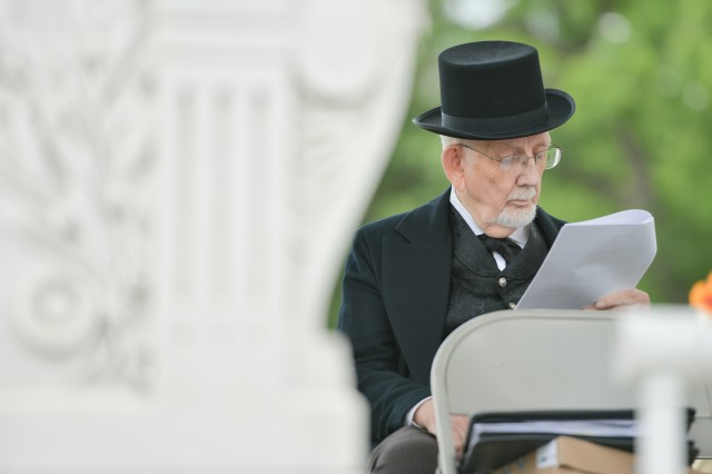 Andrew Johnson reads what he is going to say prior to a speech at a renaming ceremony May 30, 2014, for the Old Amphitheater at Arlington National Cemetery, Va. Johnson was the past commander in chief of the Sons of Union Veterans of the Civil War.
