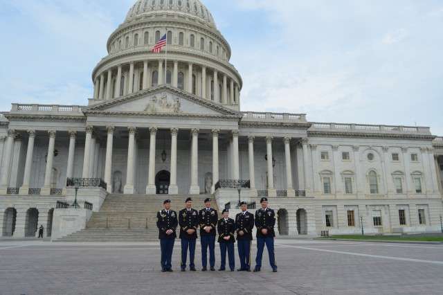 """Soldiers from 2nd Armored Brigade Combat Team, 1st Infantry Division """"Big Red One,"""" pose for a photo in front of the U.S. Capitol building's eastern front, May 28, 2014, before meeting with congressional staff to share their experiences as members of the Army's first regionally aligned brigade. Pictured from left to right are: Sgt. 1st Class Cameron M. Johnston, the brigade's senior non-commissioned provost officer; Maj. Joey L. Errington, the brigade executive officer; Col. Jeffrey D. Broadwater, the brigade commander; 1st Lt. Deseret G. Fournier, the executive officer for Headquarters and Headquarters Company, Special Troops Battalion; Capt. Walter R. Vogel, the intelligence officer for Headquarters and Headquarters Company, 1st Battalion, 63rd Armor Regiment; and Sgt. Colton D. Johnson, an unmanned aircraft system trainer with Headquarters and Headquarters Company, 1st Bn., 63rd Armor Regiment."""