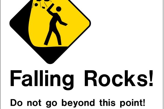 Posted signs at Sacred Falls warn trespassers.