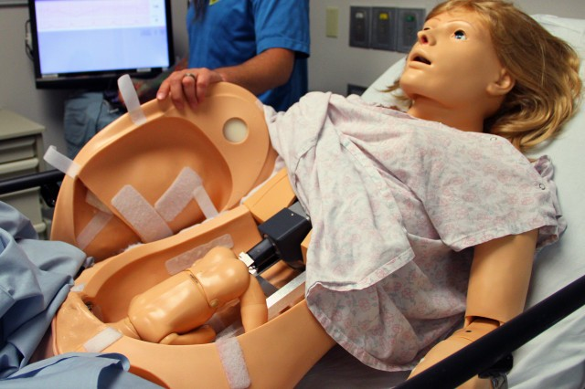 """During an open house May 27, 2014, for the Medical Simulation Center, Tripler Army Medical Center in Honolulu, displayed """"NOELLE,"""" a high-fidelity delivery manikin that can blink, breath and is warm to the touch. The robot is used for competency based programs where realistic fetal palpitations, multiple birthing scenarios, epidural procedures and more can be simulated and controlled while devices track student actions."""