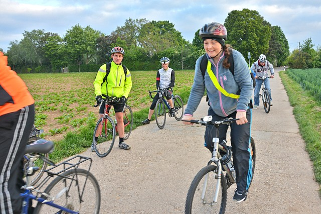 Community members make their way through the farm fields around Wiesbaden's Clay Kaserne on their way to work during National Bike-To-Work Day.